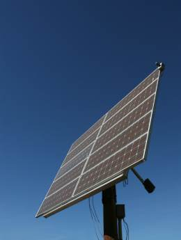 A solar array with powered tracker to track the path of the sun across the sky.